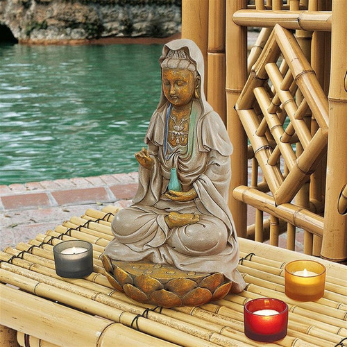 Goddess Guan Yin Seated on a Lotus Statue on Patio table