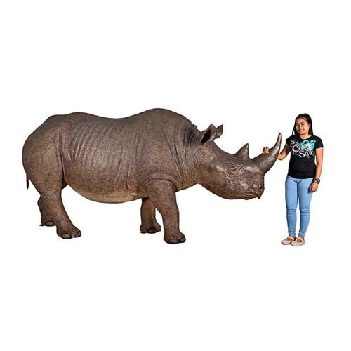 Life-Sized Rhinoceros Statue With Gardener