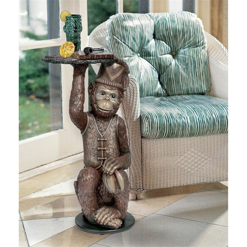 Moroccan Monkey Butler Plant Stand Next to Chair and Window