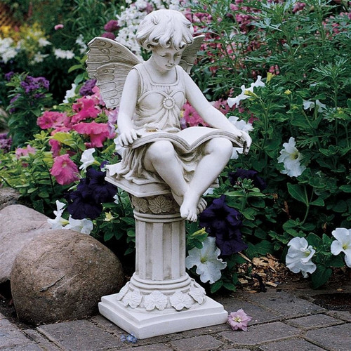 The British Reading Fairy Garden Statue Next To Plants