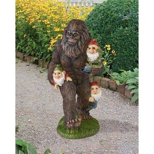 Schlepping the Garden Gnomes Bigfoot Statue in the Garden Path