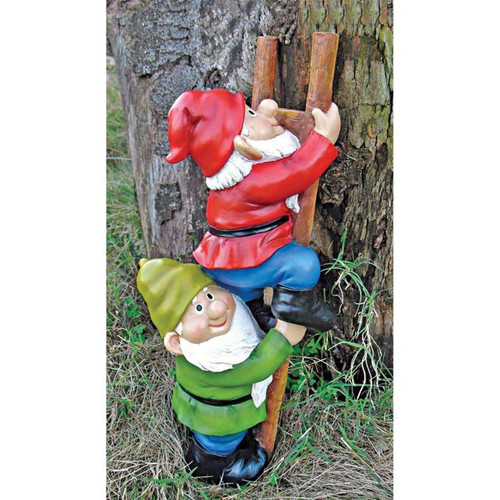 Up the Ladder Climbing Garden Gnome Statue Against a Tree