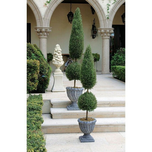 Classic Artificial Tapered Evergreen Tree Collection in the Garden