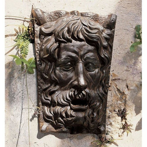 The Rotherfield Pub Greenman Cast Iron Wall Frieze in the Garden