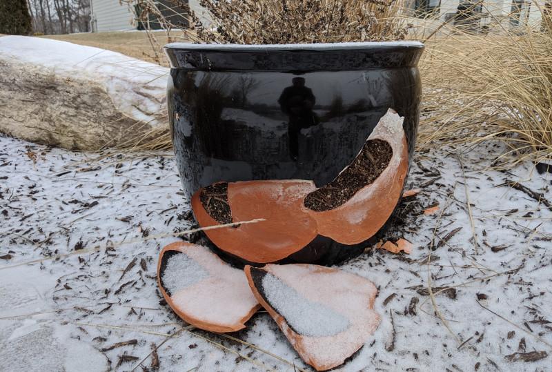 ruined-black-ceramic-planter-in-winter.jpg