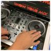 Hercules DJControl Inpulse 500 2-Channel DJ Controller in EMI Audio store with hands shown
