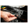 Alesis Strike Pro SE module with hand inserting SD card