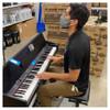 ALESIS Virtue Black 88-key Digital Piano played by EMI Audio staff member. EMI Audio