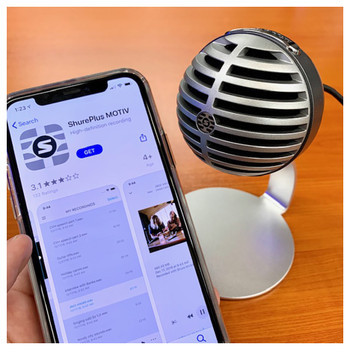 SHURE MV5/A-LTG  MV5 Digital Condenser Microphone (Gray) shown being used with a phone