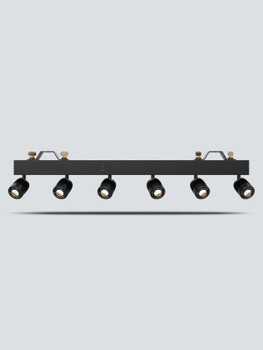 CHAUVET Pinspot Bar High-output bar with 6 independent pinspots designed to replicate traditional incandescent lamps front view shining towards camera with lights on