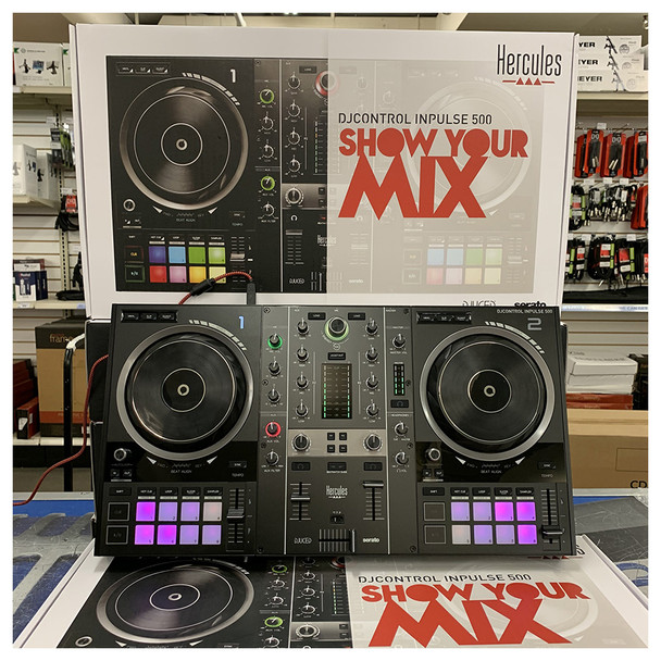 Hercules DJControl Inpulse 500 2-Channel DJ Controller in EMI Audio store with multiple boxes of other controllers shown