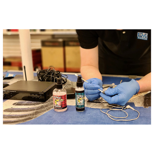 HOSA Goby Labs Headphone Cleaner being used to clean in-ear headphones, Microphone Sanitizer also pictured