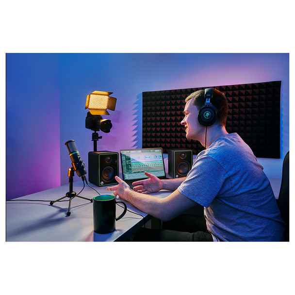 Podcaster using the MACKIE Creator Bundle - Content Creation Bundle with CR3-X Monitors, EM-USB Condenser Mic, and MC-100 Headphones. Camera, lighting, acoustic treatment not included