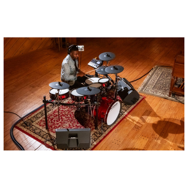 Alesis Strike Pro SE Eleven-Piece Professional Electronic Drum Kit with Mesh Heads overhead view of a drummer playing on the kit