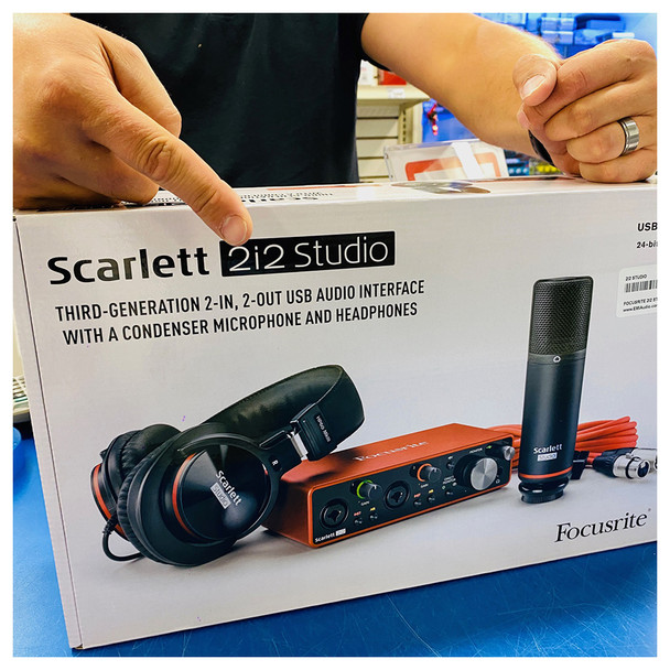 Scarlett 2i2 Studio 3rd Gen in box with finger pointing at it