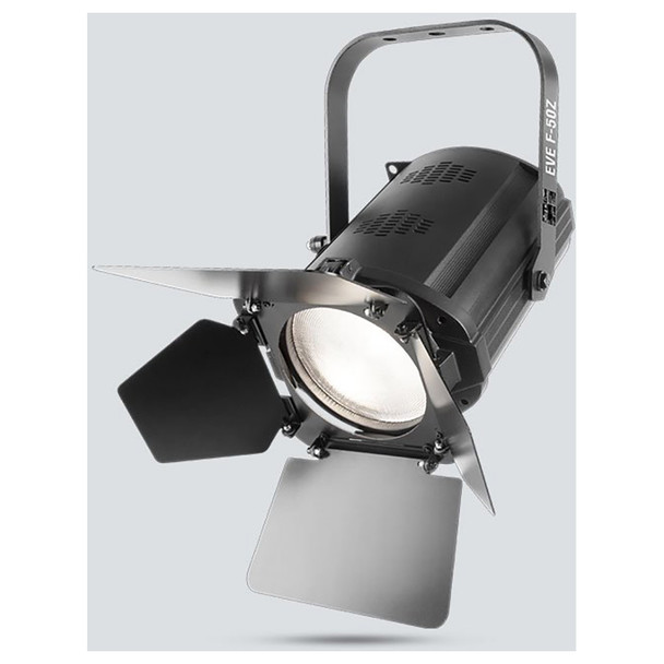 CHAUVET EVE F-50Z LED Fresnel fixture that shines a soft-edged, warm white spot and features D-Fi™ USB compatibility front/right view of warm white light shining downwards and barn doors directing light