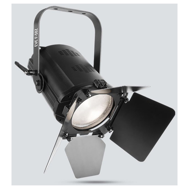 CHAUVET EVE F-50Z LED Fresnel fixture that shines a soft-edged, warm white spot and features D-Fi™ USB compatibility front/left view of warm white light shining downwards and barn doors directing light