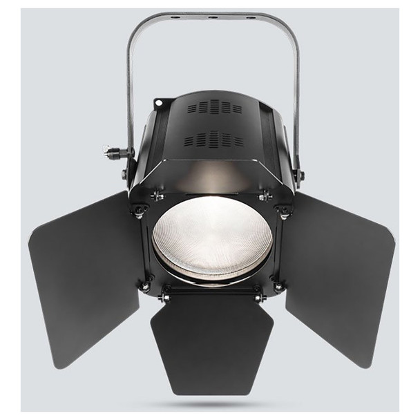 CHAUVET EVE F-50Z LED Fresnel fixture that shines a soft-edged, warm white spot and features D-Fi™ USB compatibility front view of warm white light shining downwards and barn doors directing light