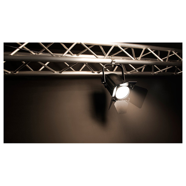 1 individual EVE F-50Z LED Fresnel fixture shining downwards from mounted position on horizontal truss