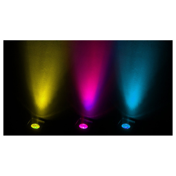 3 Freedom H1 wash lights shining upward upon black wall in yellow pink blue