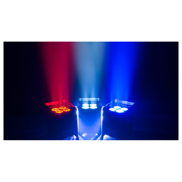 3 individual Freedom Par Quad-4 lights shining floor to ceiling in dark room in red white and blue lights