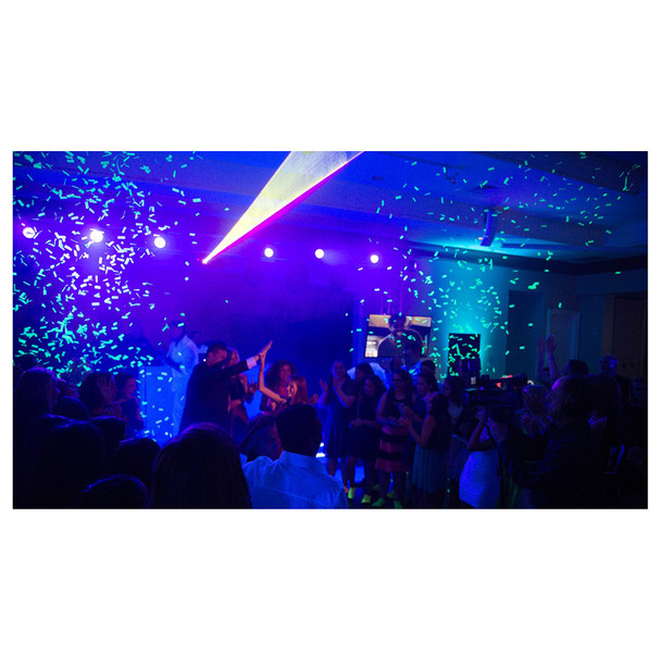 event room with crouds of people, blue lighting, and neon green confetti emitted by CHAUVET Funfetti Shot event-ready confetti launcher