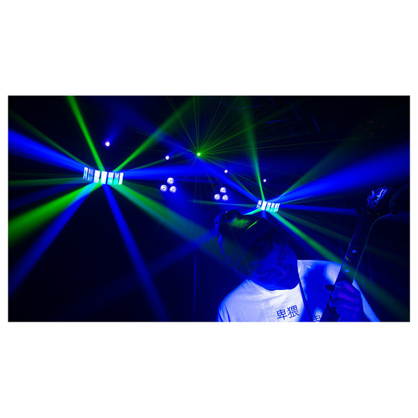 man playing guitar in front of 1 individual CHAUVET Gig Bar 2 4-in-1 light with a pair of LED derbies, LED pars, a laser, and strobe effect all illuminated in green and blue