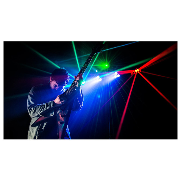 man playing guitar in front of 1 individual CHAUVET Gig Bar 2 4-in-1 light with a pair of LED derbies, LED pars, a laser, and strobe effect all illuminated in red, green and blue