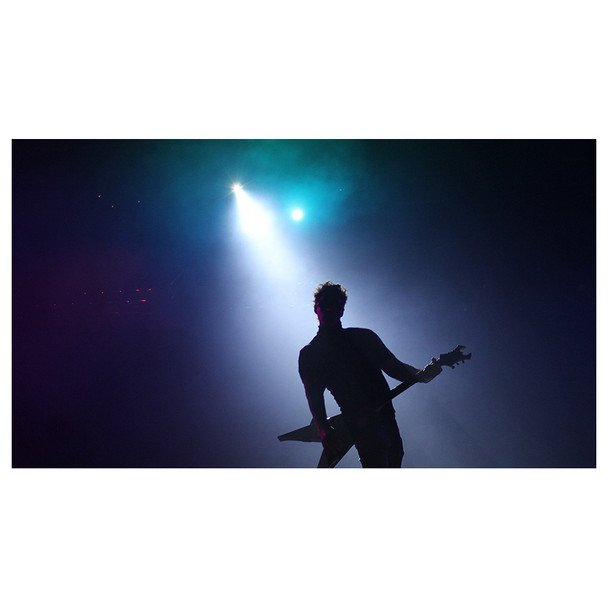 silhouette of man playing guitar with blue light shining and fog created by Hurricane 1600