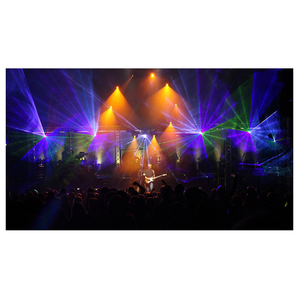 Crowd surrounding guitar player and orange/purple/green lights shining  and fog created by Hurricane 1800 Flex