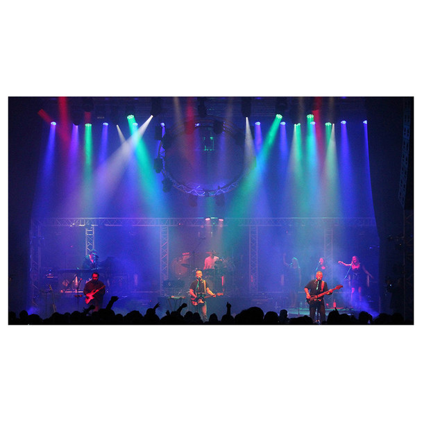 Band playing on stage with green purple and green lights shining down and fog surrounding created by Hurricane 1800 Flex