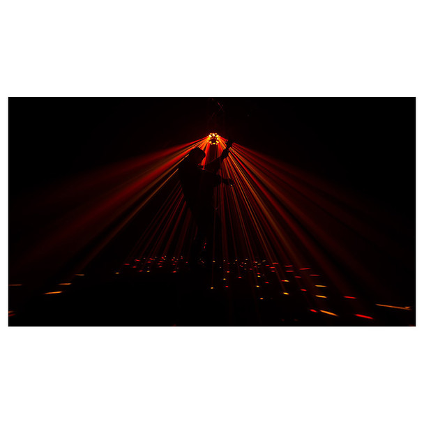 guitar player on stage with CHAUVET Swarm Wash FX shining onto him in red and orange light beams