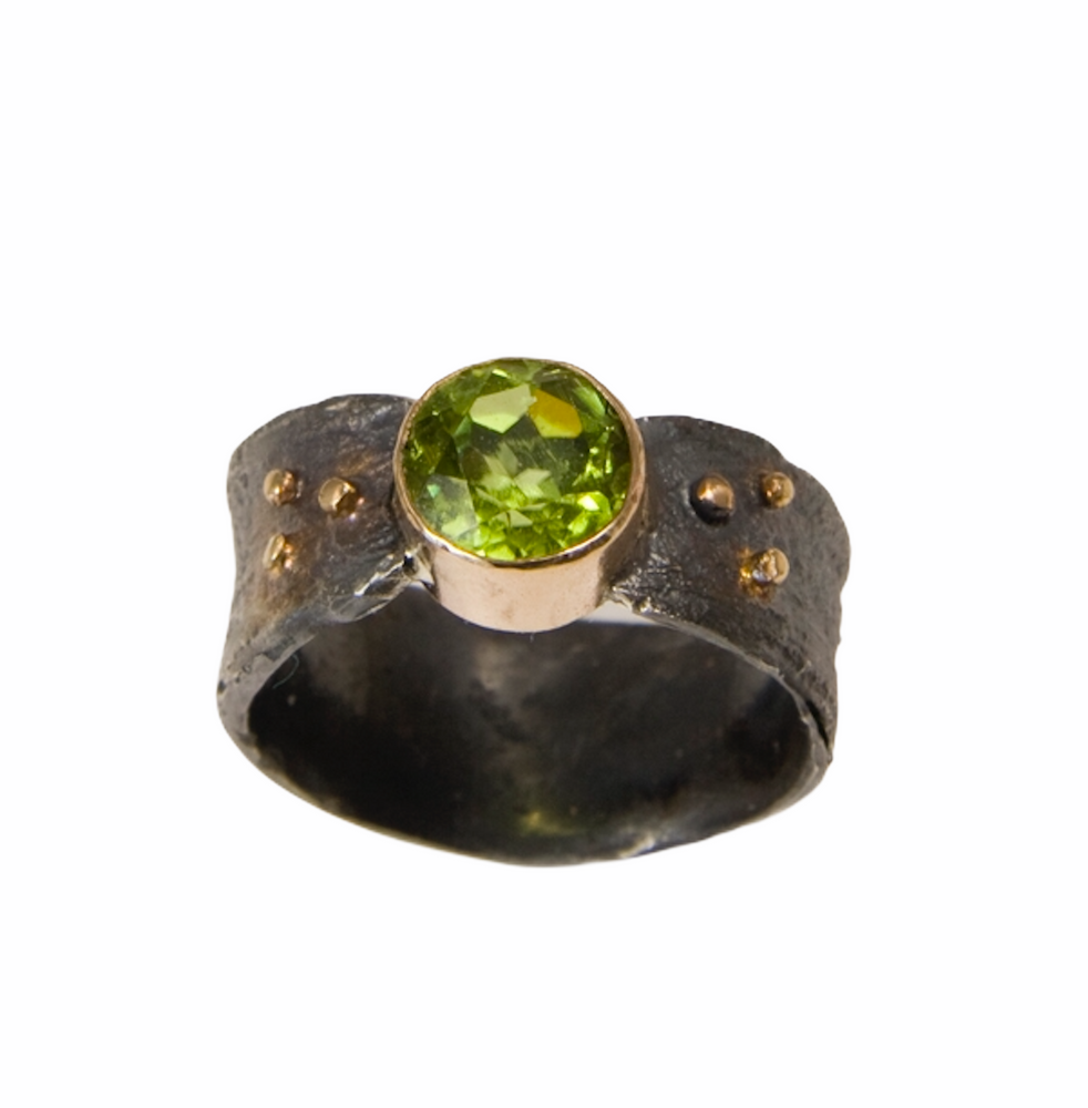 Oxidized sterling silver textured ring with faceted peridot set in 14K