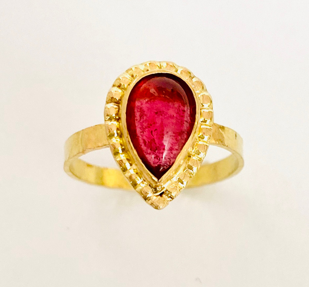 14k, 18k ring with pear shaped pink Tourmaline cabochon