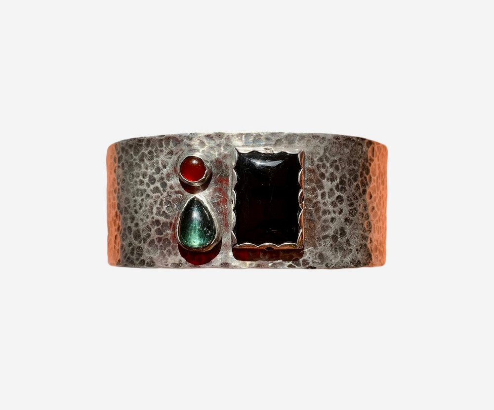Sterling silver hammered cuff bracelet, patinated with black. Blue/green tourmaline, carnelian and onyx. designed and handmade by J A Lindberg