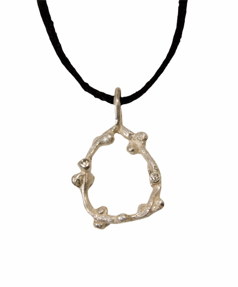 Sterling silver vine pendant with white sapphires, on a black suede cord.