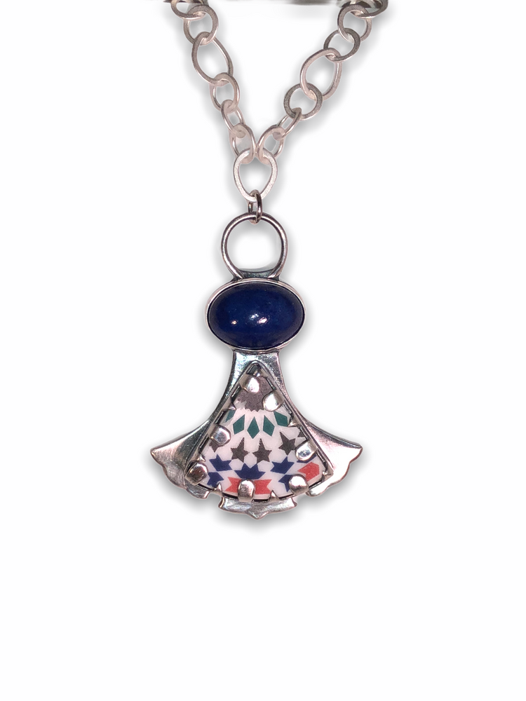 """Sterling Silver with High domed oval Lapis and ceramic 'cabochon' pendant. Hand fabricated bezel and backplate. 18"""" brushed silver, irregular link chain with sliver lobster clasp."""