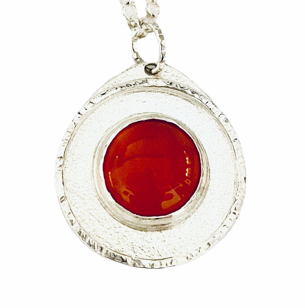Sterling silver pendant set with round cabochon Carnelian
