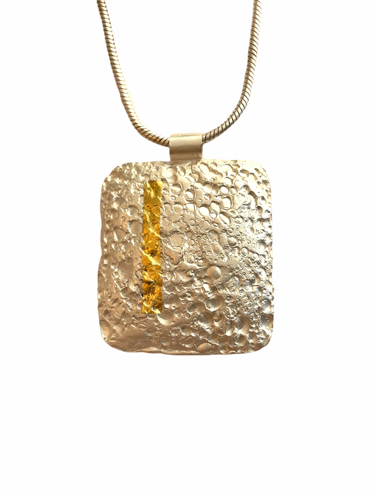 Textured sterling silver and 24K gold pendant
