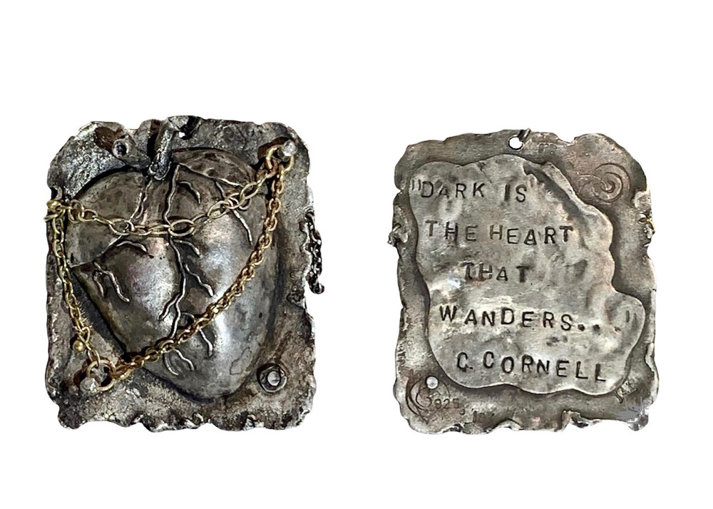 """One of a kind, sterling silver, and hand fabricated repousse heart pendant w/14 & 18k gold. designed and handmade by J A Lindberg. Chris Cornell lyric from """"Circling""""on reverse, """"Dark is the heart that wanders"""""""