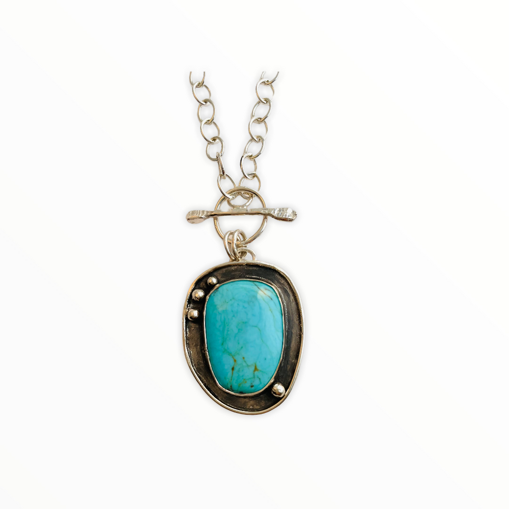 Sterling silver and turquoise pendant on a cable chain