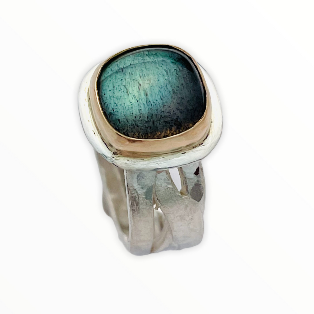 Blue green labradorite set in 14K gold on a sterling silver band