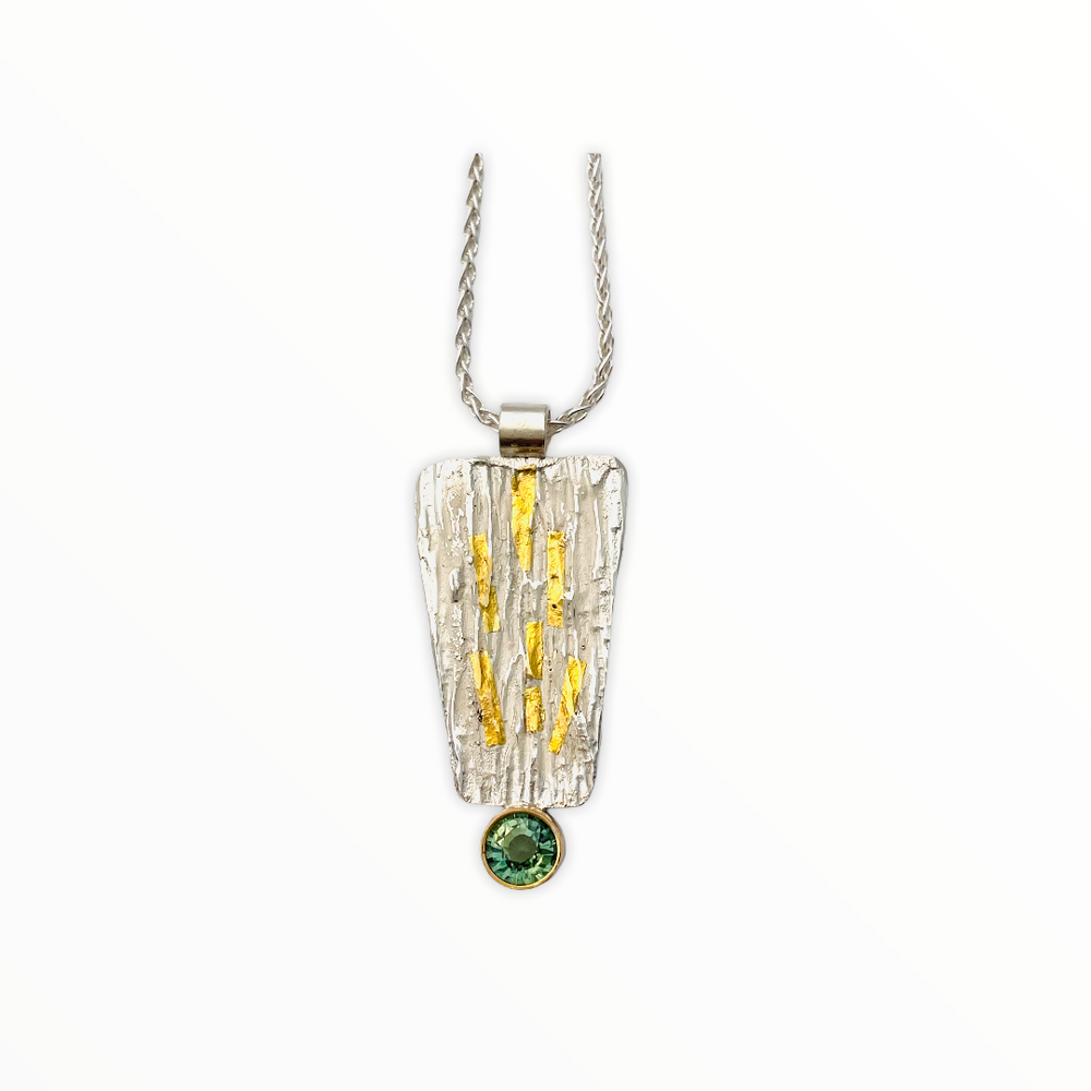 Sterling silver textured pendant with green tourmaline set in gold on a sterling wheat chain