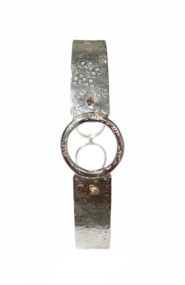 Fine and sterling silver handcrafted bangle with adjustable clasp and 18k gold flowerets. One of a kind. Everyday for casual or dressy.  designed and handmade by, J A Lindberg.