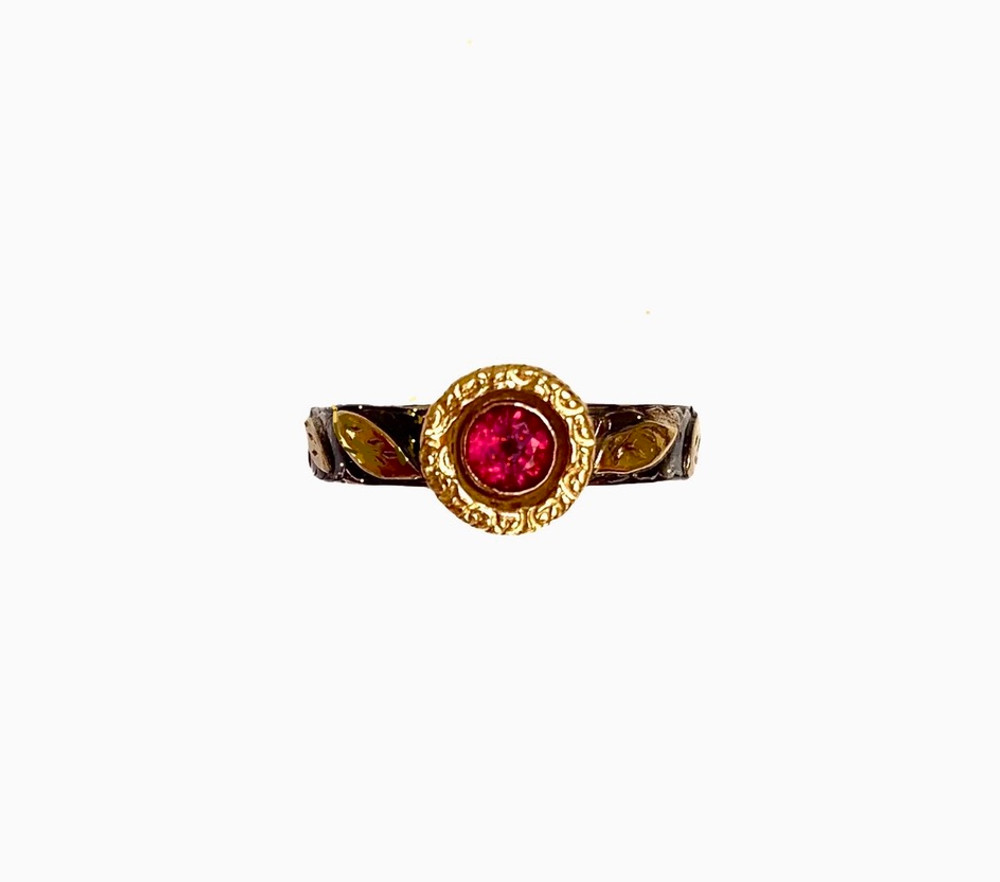 top view of ruby, 18k gold and sterling ring