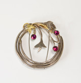 Sterling silver wreath with 14K gold branches and rhodolite garnet flowers make this a classic elegant brooch