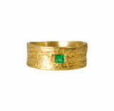 18k textured ring with faceted emerald.