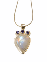 Rainbow moonstone pendant  with faceted iolite set in sterling silver