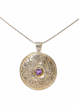 Patterned sterling silver pendant with faceted amethyst