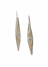Sterling silver spiculum earrings with blue topaz